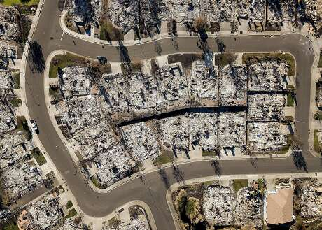 Homes leveled by the Tubbs fire line Bella Vista Way in Santa Rosa, Calif., on Thursday, Dec. 21, 2017. The neighborhood lies across Fountaingrove Parkway from the proposed Round Barn Village development project that faces opposition amid concerns about future wildfires.