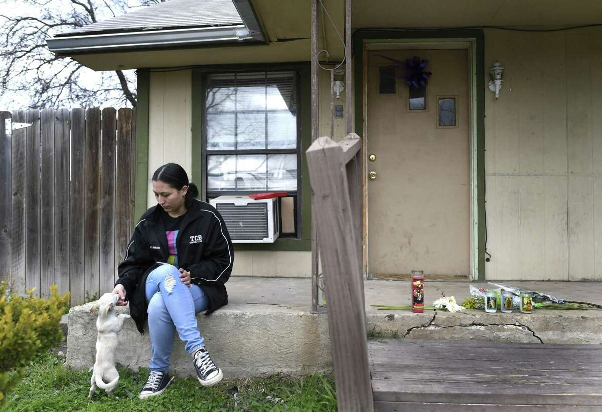 Sammy Arellano, the fiancée of slain boxer John Duane VanMeter, sits on the porch of her Uvalde home on Jan. 25, 2019. VanMeter was shot and killed two days earlier inside the home. A 12-year-old boy was charged in his death. She pets her puppy, who was splashed with VanMeter's blood.