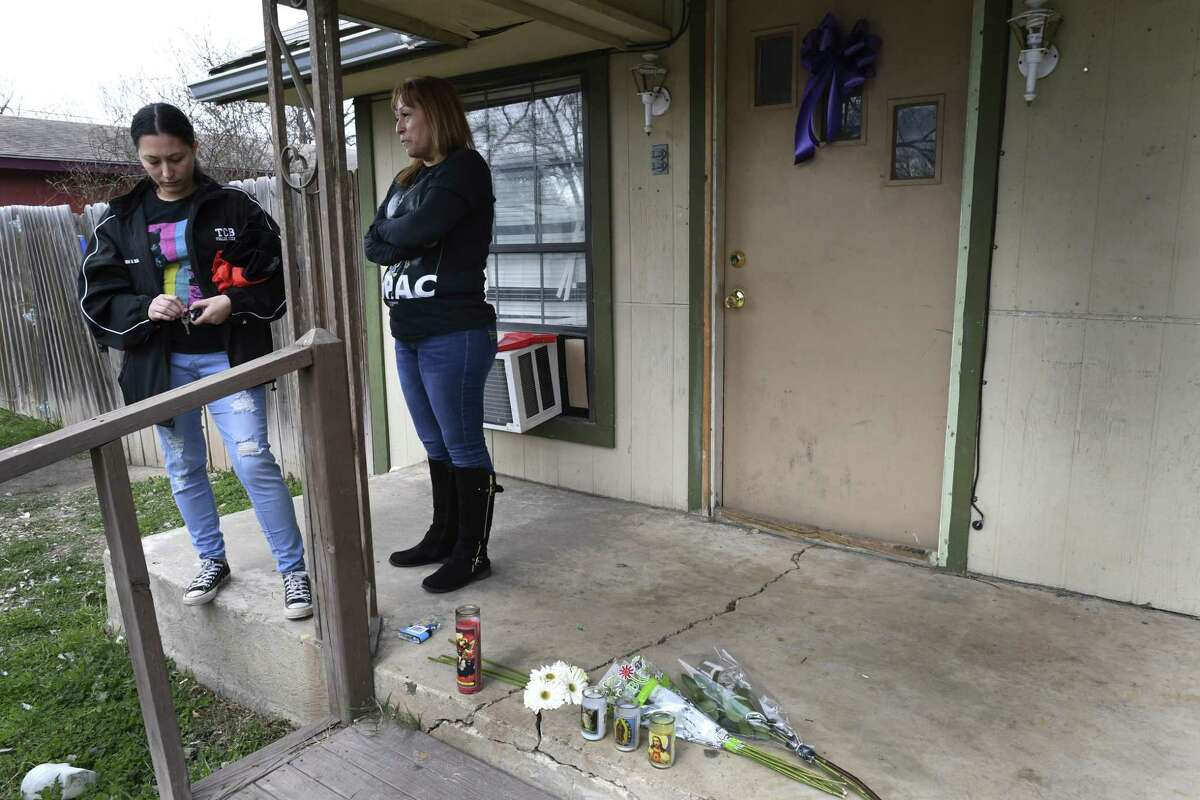 Sammy Arellano, left, the fiancée of slain boxer John Duane VanMeter, and her mother, Norma Arellano, stand outside the home Jan. 25, 2018, where VanMeter died. He was shot and killed Jan. 23. A 12-year-old boy who had stayed with VanMeter and Sammy Arellano was charged in his death.
