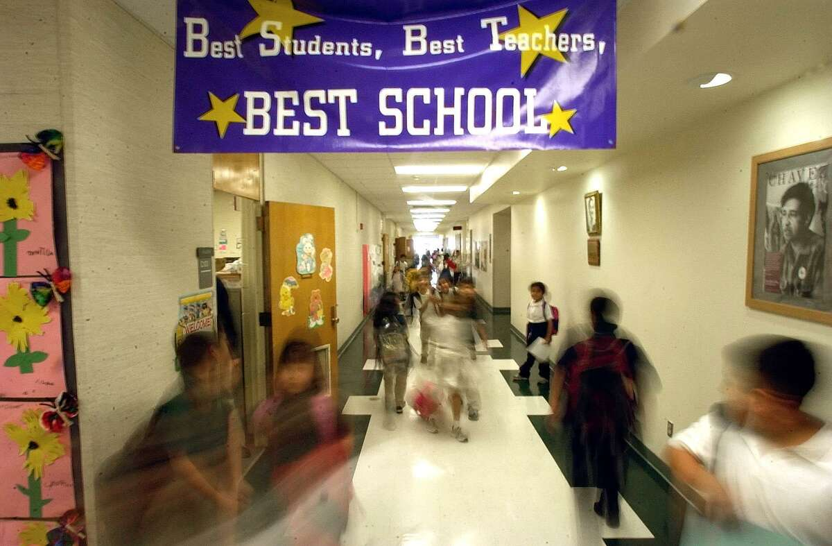 Students walk the halls of Carrollton Elemetary School in Carrollton in 2004. Studies demonstrate that schools fail poor students, not the other way around.