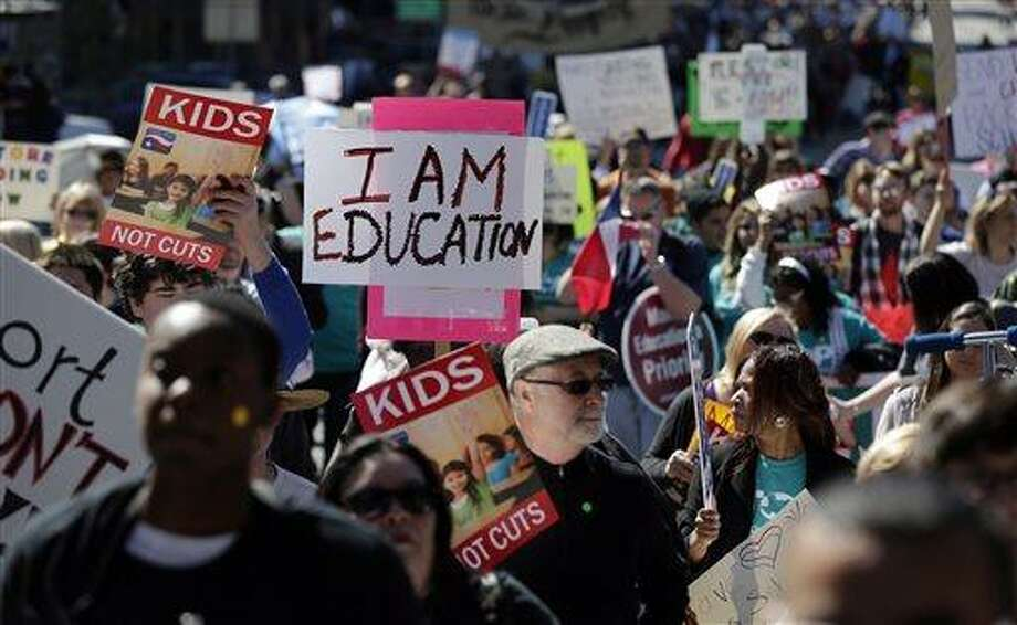 In 2013, marchers in Austin rally for public schools. This year, few legislators disagree on the need to boost school funding. How to make it sustainable is the problem. Photo: Associated Press File Photo / AP
