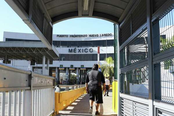 Pedestrians cross the Gateway to the Americas International Bridge into Nuevo Laredo, Mexico, in 2016. In days past, the border seemed seamless. Today, politics are feeding a divide.