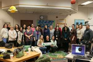 Twenty-two parent volunteers, pictured above with school and Junior Achievement officials, helped make JA in a Day a reality on Wednesday, Jan. 16.