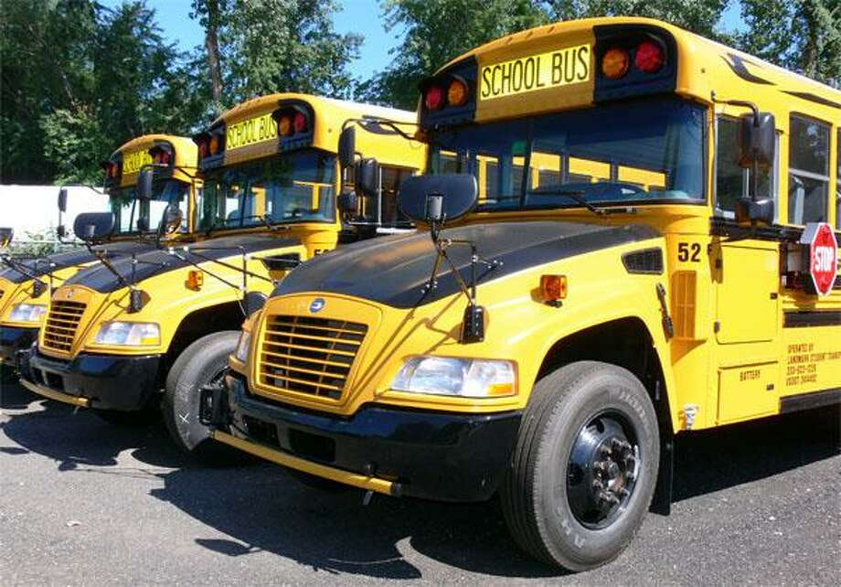 Some of the city's propane buses. Photo: Brian Gioiele