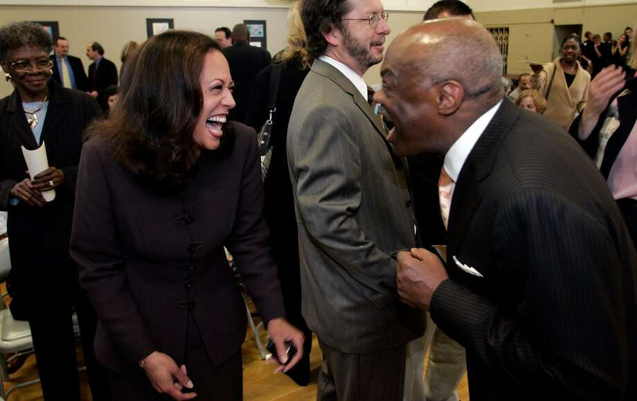 Kamala Harris, then San Francisco's district attorney, laughs with Willie Brown at an event in September 2005. Photo: Carlos Avila Gonzalez / The Chronicle 2005