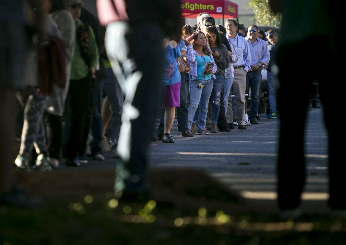 Voters wait in line on the last day of early voting at Brook Hollow Library, San Antonio's busiest precinct, on Friday, Nov. 2, 2018.