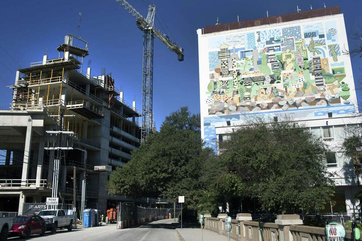 """Work continues Thursday, Jan. 24, 2019 on the Arts Residences at the Thompson building, left, at 123 Lexington Ave in downtown San Antonio. Development firm DC Partners is building the high-rise with help from a $10 million incentive package from the Center City Housing Incentive Policy, a program that gives developers property tax rebates and construction loans to build housing in downtown San Antonio. The policy was a key component of Julian Castro's """"Decade of Downtown."""""""