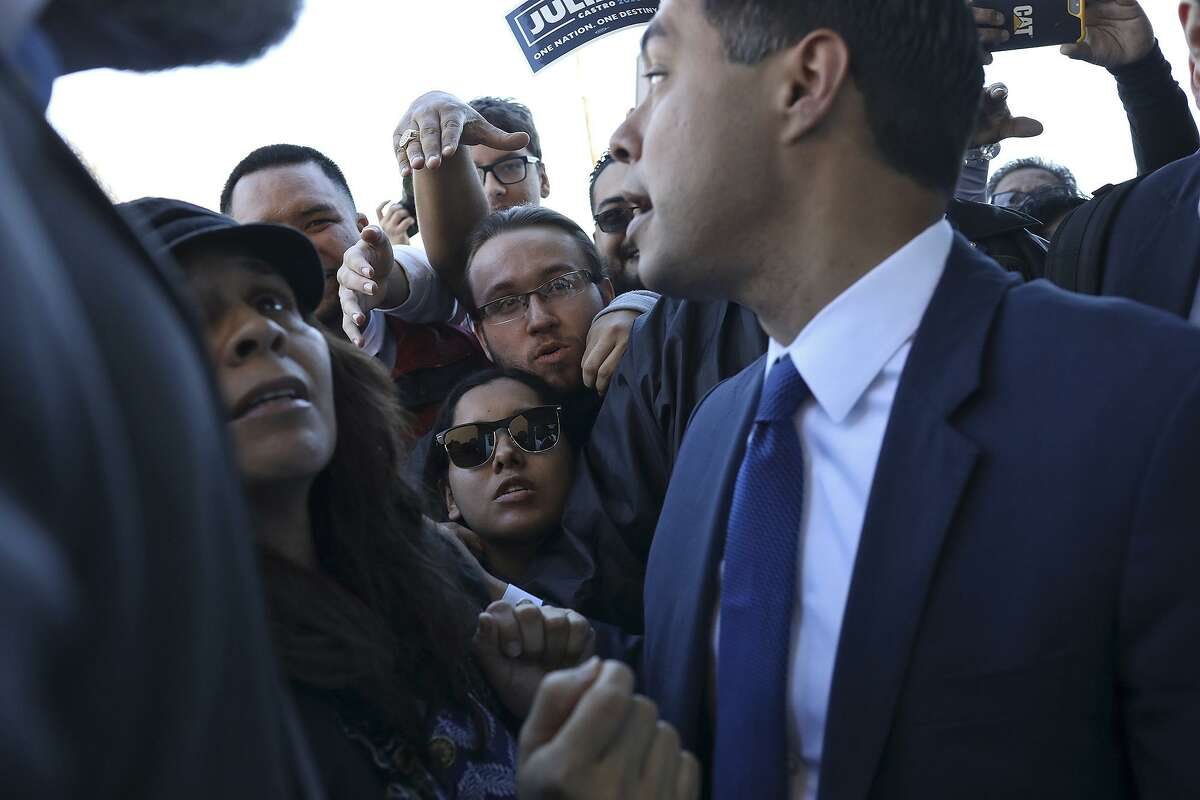 Jeanie Vasquez, center, and Robert Castaneda, wait to talk to Julian Castro, former HUD Secretary and former mayor of San Antonio, after he announced his run for President of the United States at Plaza Guadalupe in San Antonio on Saturday, Jan. 12, 2019. Vasquez and Castaneda hope to volunteer as field organizers.