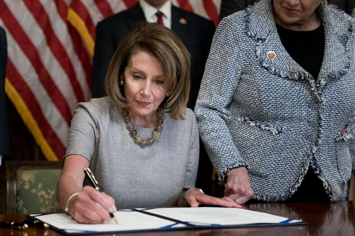 **EDS: RETRANSMISSION OF XNYT172 SENT 01/25/2019 TO CORRECT BYLINE TO ERIN SCHAFF, NOT SILBIGER** House Speaker Nancy Pelosi (D-Calif.) signs a bill to reopen the federal government, on Capitol Hill in Washington, Jan. 25, 2019. The plan includes no money for a border wall and was essentially the same approach President Donald Trump rejected in December, meaning he won nothing concrete during the impasse. (Erin Schaff/The New York Times)