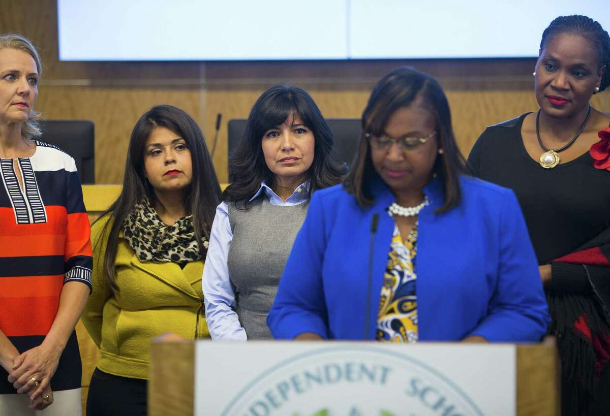 In this October 2018 file photo, Houston ISD trustees (LtoR) Sue Deigaard, Elizabeth Santos, Diana Dávila and Wanda Adams listen as Interim Superintendent Grenita Lathan addresses the media during a press conference at the Hattie Mae White Educational Support Center. Trustees apologized for the turmoil among the school board and stated that Lathan would continue to serve as the interim superintendent.