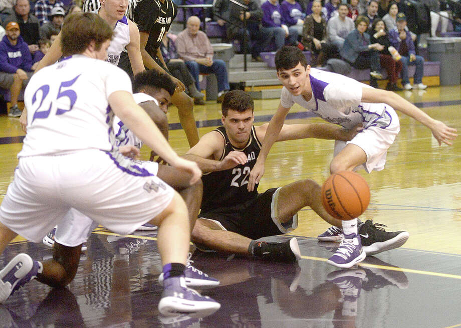Port Neches-Groves' Drake Rojas (right) and Riley Abel move in to recover the loose ball after stripping it away from Nederland's Garrett Rahe during Friday night's match-up at PNG.  Photo taken Friday, January 25, 2019 Photo by Kim Brent/The Enterprise Photo: Kim Brent, The Enterprise / BEN