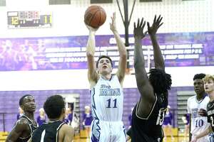 Nederland defends as Port Neches-Groves' Trent Lee puts up a jumper during Friday night's match-up at PNG.  Photo taken Friday, January 25, 2019 Photo by Kim Brent/The Enterprise