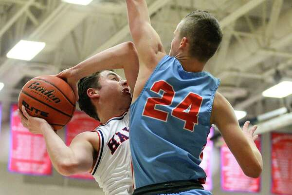 Hardin-Jefferson's Jaystan Davis attempts a layup as Lumberton's Brock Mcclure defends during the first half of the game in Hardin-Jefferson on Friday. Photo taken on Friday, 01/25/19. Ryan Welch/The Enterprise