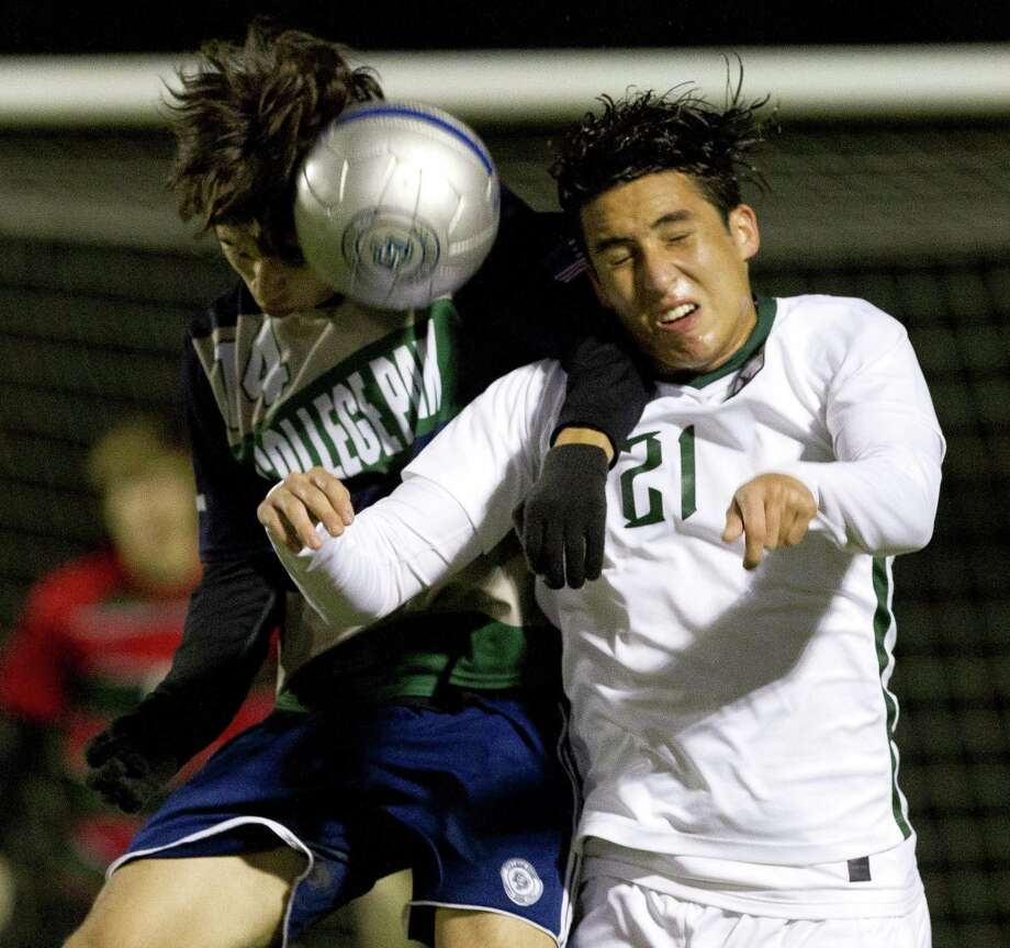 The Woodlands defender Silvino Fernandez (21) attempts the head the ball against College Park forward Jesse Botello (14) during the second period of a District 15-6A high school soccer match at College Park High School, Friday, Jan. 25, 2019, in The Woodlands. Photo: Jason Fochtman, Houston Chronicle / Staff Photographer / © 2019 Houston Chronicle