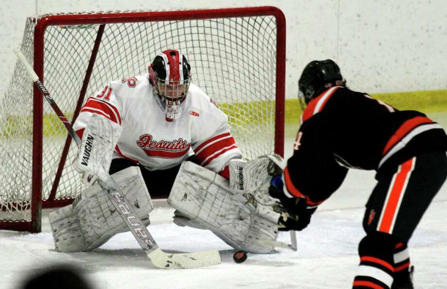 Fairfield Prep goalie Jake Walker deflects a shot by Ridgefield's Will Forrest during a Dec. 12 game at the Wonderland of Ice in Bridgeport. Photo: Christian Abraham / Hearst Connecticut Media / Connecticut Post