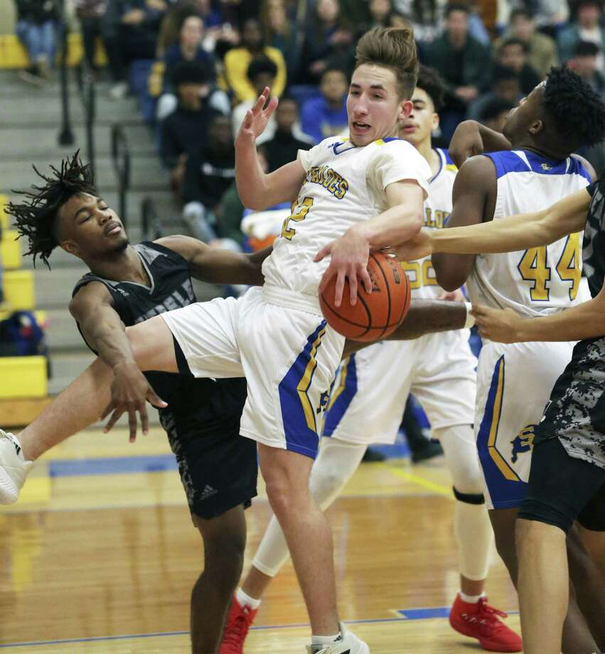 Clemens guard Alden Ingalls moves the ball away from Quenley Shepard on a rebound as Clemens hosts Steele in boys basketball on January 25, 2019. Photo: Tom Reel, Staff / Staff Photographer / 2019 SAN ANTONIO EXPRESS-NEWS