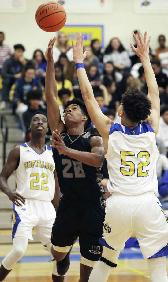 The Knight's Jackson Byas slips a floater up in traffic as Clemens hosts Steele in boys basketball on January 25, 2019. Photo: Tom Reel, Staff / Staff Photographer / 2019 SAN ANTONIO EXPRESS-NEWS