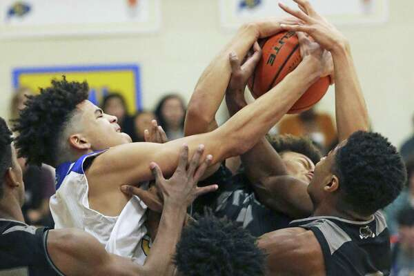 Clemens big man Kavon Booker battles for a rebound in a crowd as Clemens hosts Steele in boys basketball on January 25, 2019.
