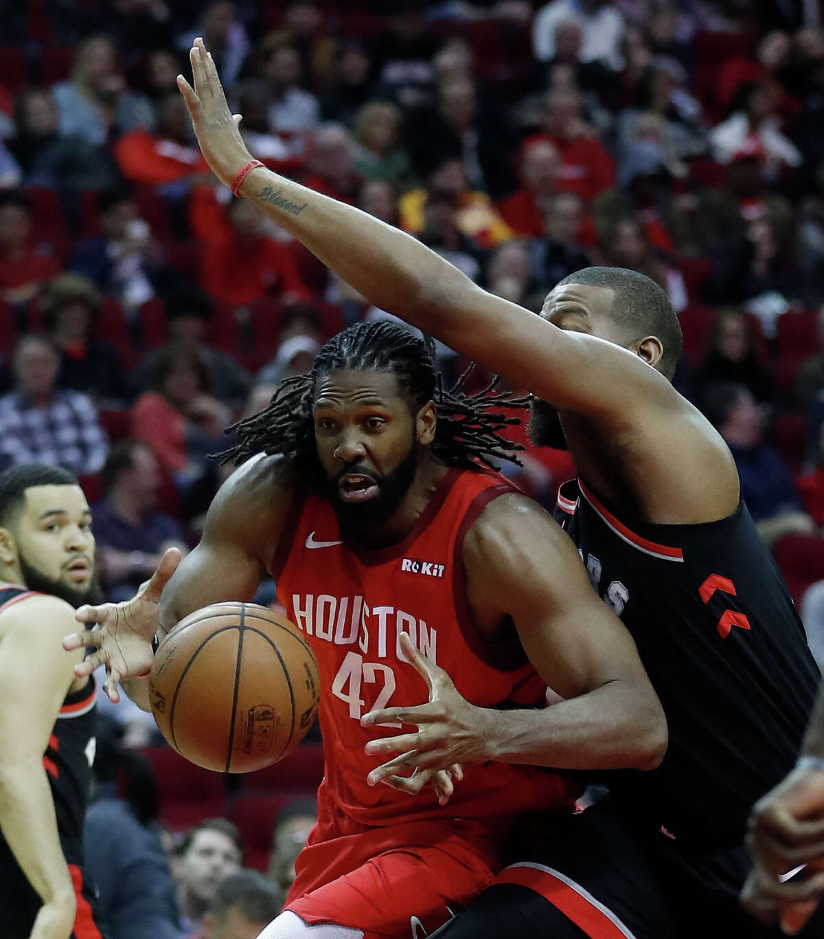 Houston Rockets center Nene Hilario (42) drives past Toronto Raptors center Greg Monroe (15) during the first half of an NBA basketball game at Toyota Center, Friday, Jan. 25, 2019, in Houston. J