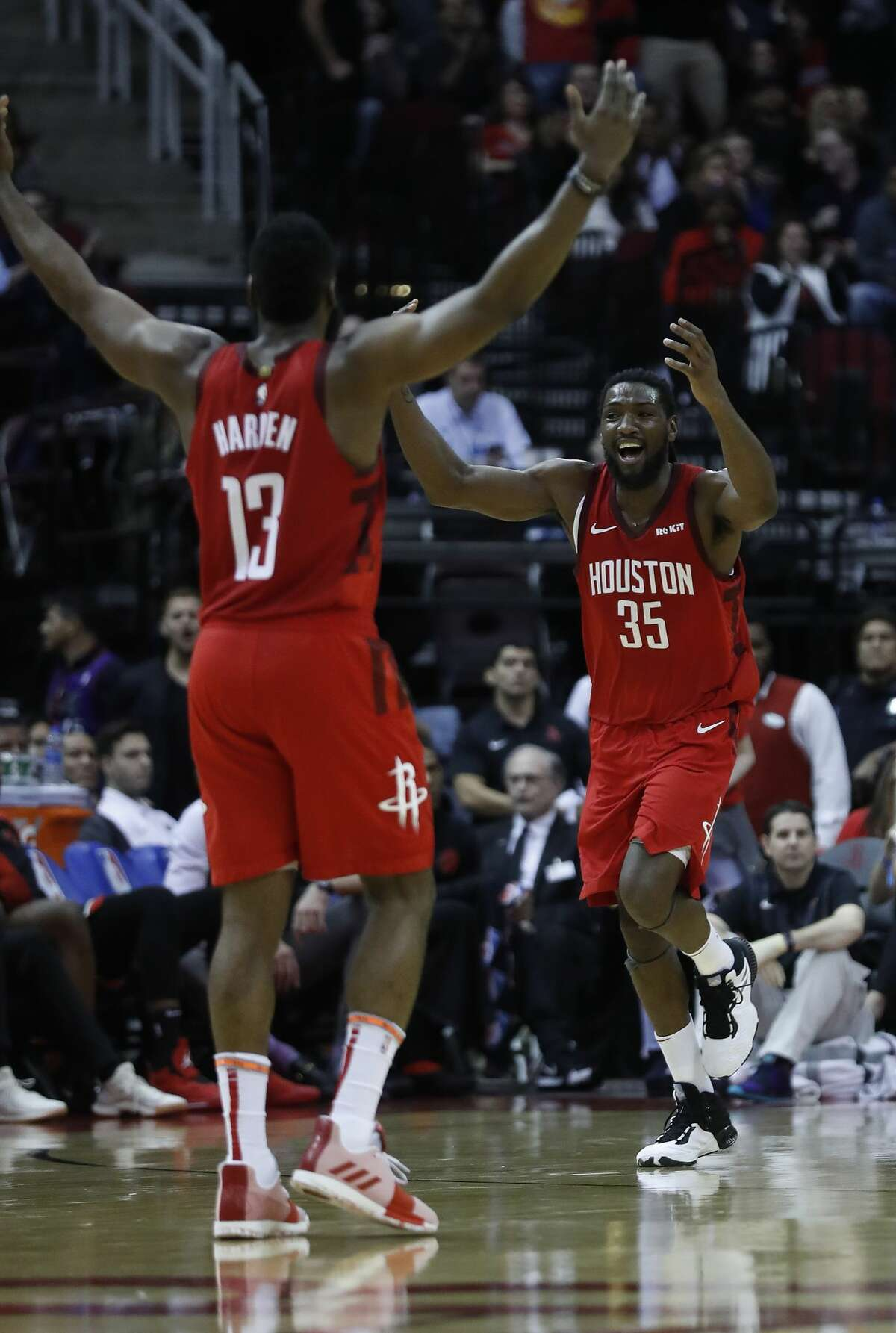 Houston Rockets forward Kenneth Faried (35) celebrates a basket scored against Toronto Raptors with guard James Harden (13) during the second half of an NBA basketball game at Toyota Center, Friday, Jan. 25, 2019, in Houston.