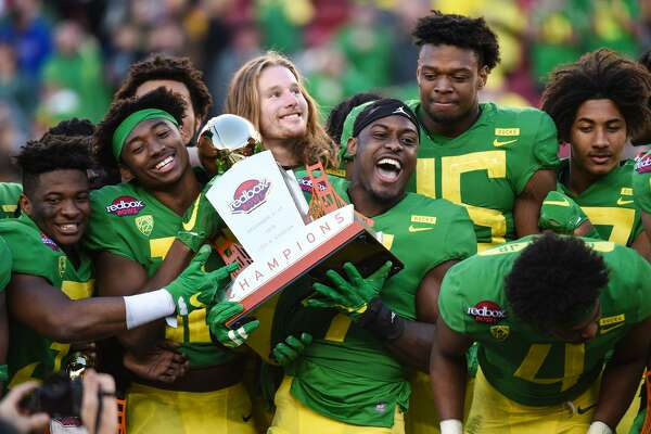 SANTA CLARA, CA - DECEMBER 31: Oregon Ducks players including Oregon Ducks Safety Ugochukwu Amadi (7) celebrate with the Redbox Bowl trophy after the Redbox Bowl between the Michigan State Spartans and the Oregon Ducks at Levi's Stadium on December 31, 2018 in Santa Clara, CA. (Photo by Cody Glenn/Icon Sportswire via Getty Images)