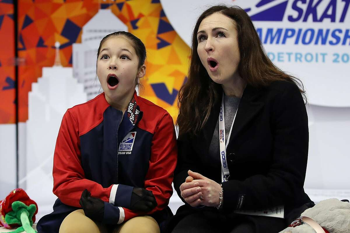 DETROIT, MICHIGAN - JANUARY 25: Alysa Liu and her coach Laura Lipetsky react after moving into first place after her Championship Ladies Free Skate during the 2019 Geico U.S. Figure Skating Championships at Little Caesars Arena on January 24, 2019 in Detroit, Michigan. (Photo by Gregory Shamus/Getty Images)