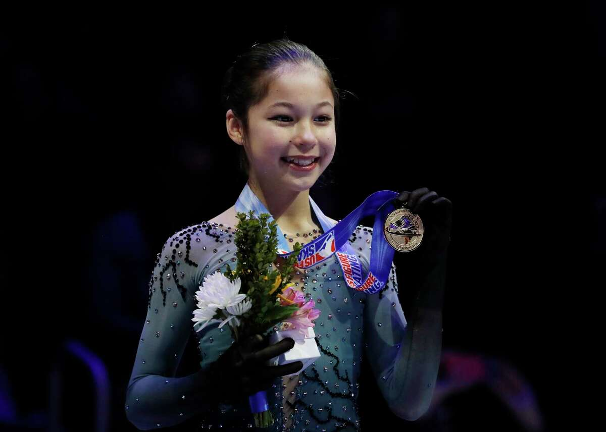 Alysa Liu holds her medal after winning the the women's title during the U.S. Figure Skating Championships, Friday, Jan. 25, 2019, in Detroit.