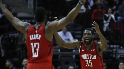 890a0f67f33 Houston Rockets forward Kenneth Faried (35) celebrates a basket scored  against Toronto Raptors with guard James Harden (13) during the second half  of an NBA ...