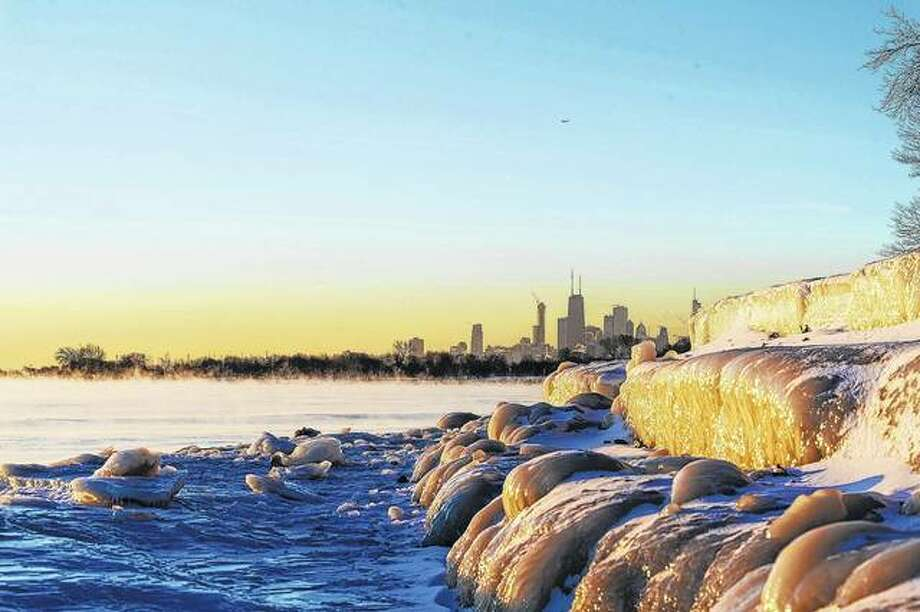 Chicago's lakefront is frozen over Friday. The National Weather Service had a wind chill warning in effect for many parts of northwestern and north-central Illinois. Photo: Tyler LaRiviere | Chicago Sun-Times (AP)
