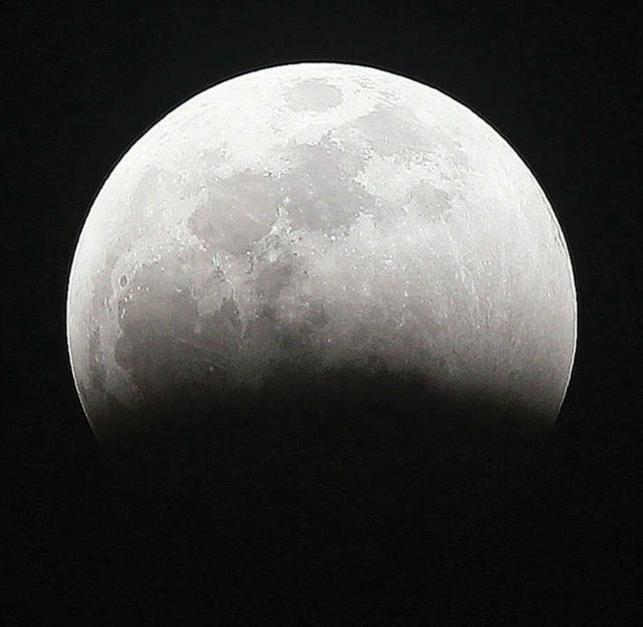 "The earth's shadow starts moving across a full moon late Sunday and into early Monday morning during a ""Super Blood Wolf Moon"" total lunar eclipse. Photo: John Badman 