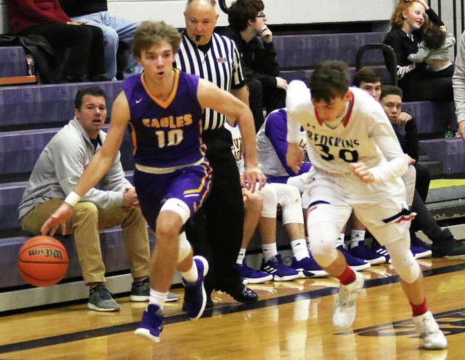 CM's Bryce Zupan (left) drives past Nokomis' Mason Stewart during a game earlier this month at the Litchfield Tournament. On Friday night back home in Bethalto, Zupan scored 35 points in the Eagles' MVC victory over Waterloo. Photo: Greg Shashack / The Telegraph