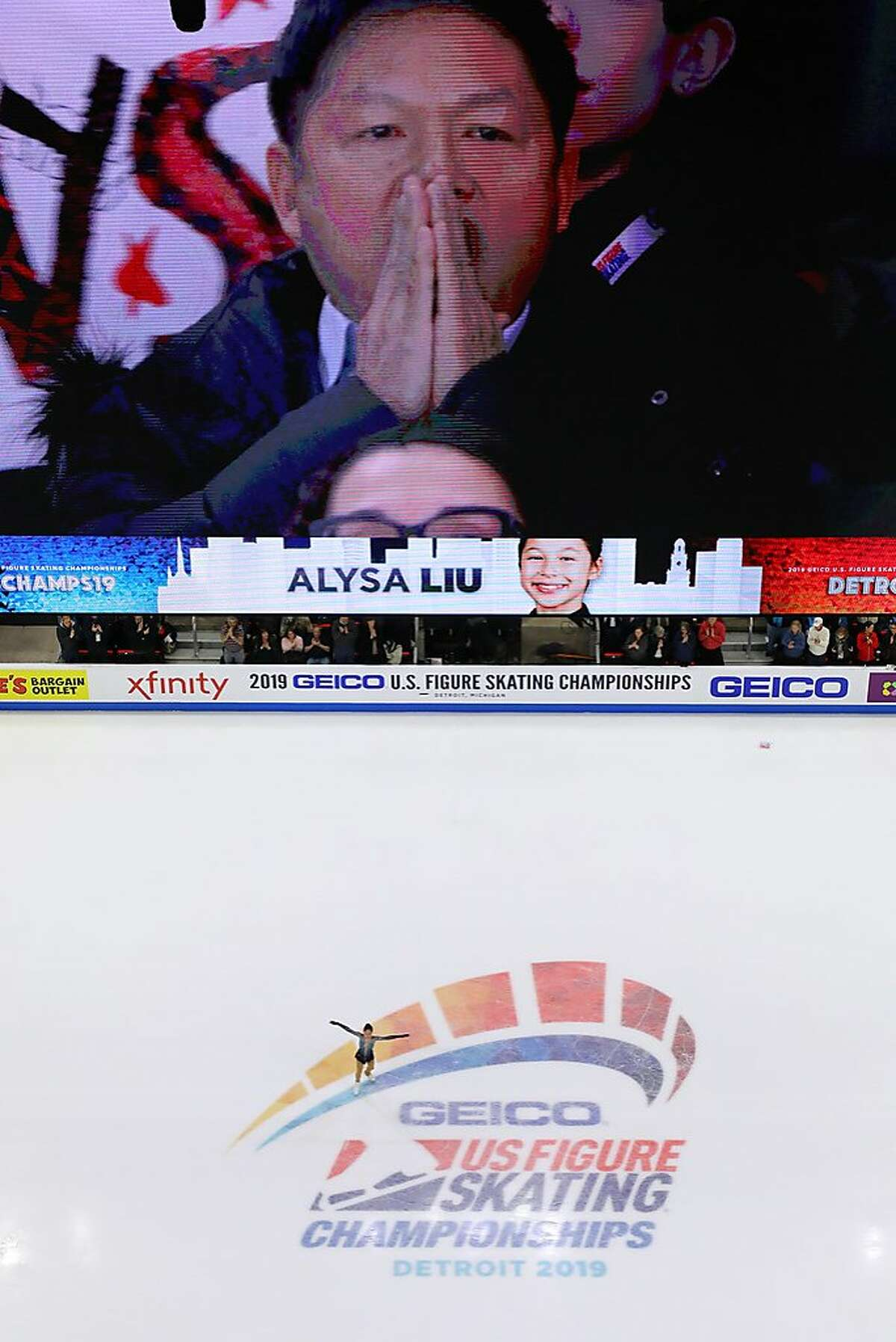 DETROIT, MICHIGAN - JANUARY 25: Alysa Liu finishes her Championship Ladies Free Skate while her father Arthur Liu reacts on the jumbotron above the ice during the 2019 U.S. Figure Skating Championships at Little Caesars Arena on January 25, 2019 in Detroit, Michigan. (Photo by Gregory Shamus/Getty Images)