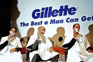 "In this file photo from Feb. 4, 2007, (From L to R) Swiss tennis player Roger Federer, French football player Thierry Henry and US golfer Tiger Woods take part in promotion for US razor giant Gillette in Dubai. Procter & Gamble said on Jan. 15 its controversial Gillette ad targeting ""toxic masculinity"" was resonating with younger consumers and producing solid sales despite criticism from some conservatives and calls for a boycott."