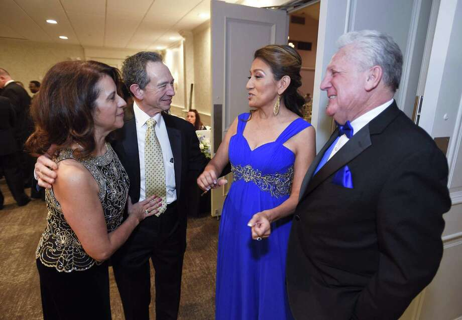 From left, Anna and Cesar Ramirez chat with Lucia and Norwalk Mayor Harry Rilling during the City of Norwalk's 26th annual Mayor's Community Ball at the Serafina at the Italian Center in Stamford on Friday. At right, the Rillings chat with Dan and Elsa Obuchowski during the ball. Photo: Matthew Brown / Hearst Connecticut Media / Stamford Advocate