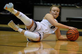 Midland Classical's Kori Kirk goes after a loose ball against Fort Worth Lake Country Jan. 26, 2019, at MCA. James Durbin/Reporter-Telegram