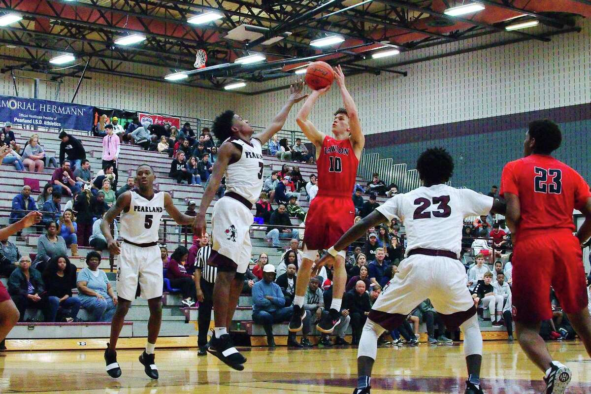 Dawson's Hunter LaCoste (10) puts up a shot over Pearland's Alphonso Tyler (3) Friday at Pearland High School.