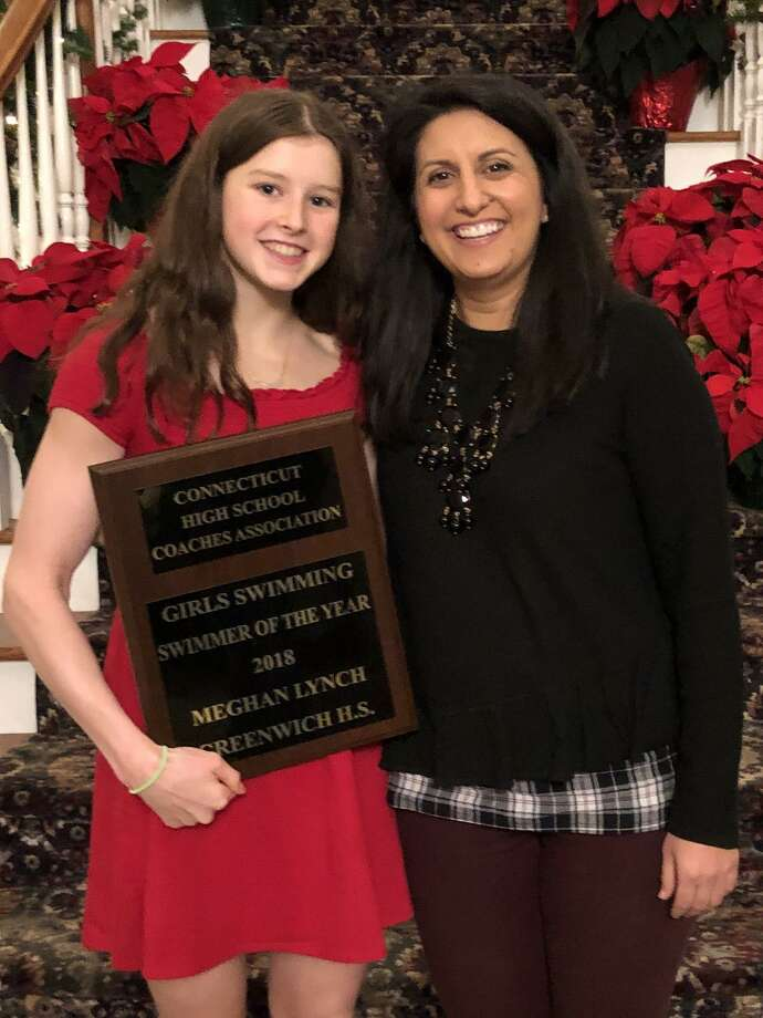 Greenwich High School sophomore Meghan Lynch, left, was selected as the Connecticut High School Coaches Association Girls Swimmer of the Year for the 2018 season. Lynch produced a record-breaking season for the Cardinals, who won the State Open, Class LL and FCIAC Championships. Pictured with Lynch is Greenwich coach Lorrie Hokayem. Photo: Contributed Photo / Greenwich Time Contributed