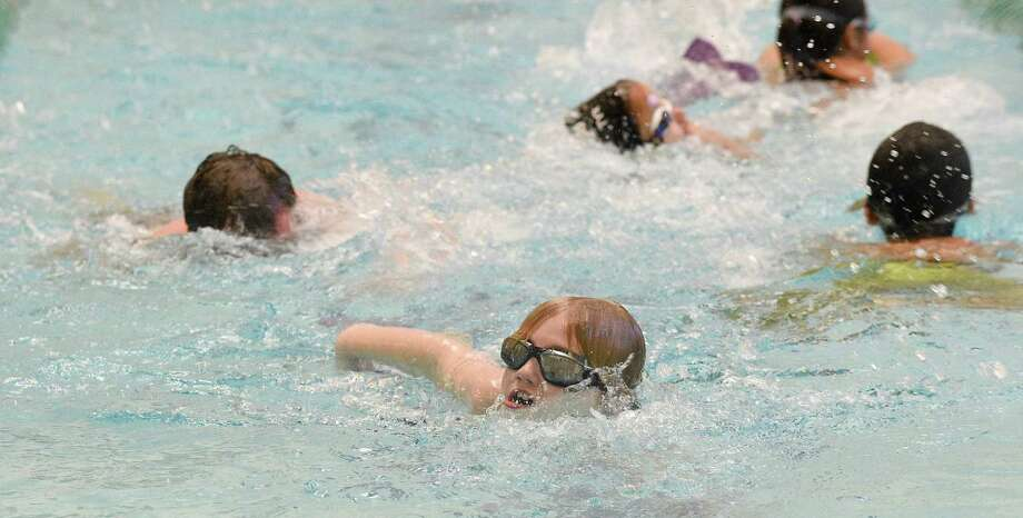 Liam McGrath, 8, of Riverside, center, joined several participants in the pool as they complete laps as part of the 14th annual Swim-a-thon at the Boys and Girls Club of Greenwich on Saturday, Jan. 26, 2019. Over 100 swimmers of all ages participated in the event which set a goal to raise $25,000 dollars the club's aquatics program in Greenwich, Connecticut. Photo: Matthew Brown / Hearst Connecticut Media / Stamford Advocate