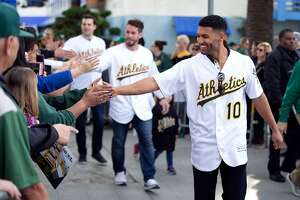 A's shortstop Marcus Semien (10) greets the fans at Oakland Athletics FanFest 2019, at Jack London Square in Oakland, Calif., Saturday, Jan. 26, 2019. A's supporters arrived by the thousands to see their favorite players, coaches and former stars as the club prepares for the new baseball season.