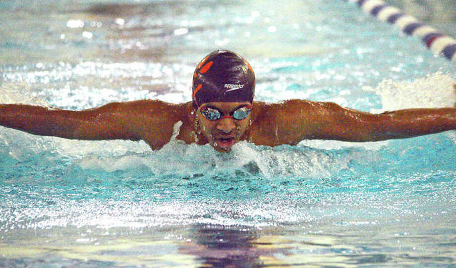 Edwardsville's Javier DeLaCruz swims in the 100-yard butterfly during Saturday's dual meet against Springfield High at Chuck Fruit Aquatic Center. Photo: Scott Marion/Intelligencer