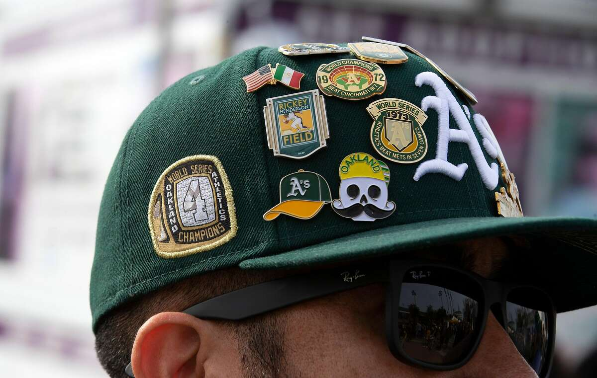 A devoted fan sports a hat covered with pins at Oakland Athletics FanFest 2019, at Jack London Square in Oakland, Calif., Saturday, Jan. 26, 2019. A's supporters arrived by the thousands to see their favorite players, coaches and former stars as the club prepares for the new baseball season.