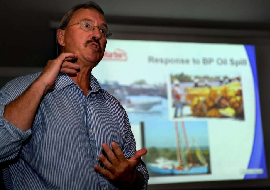 Jon Menti of CleanHarbors talks about the company's work helping to contain and clean up the BP oil spill in the Gulf of Mexico during an event at Bridge House restaurant in Milford on Wednesday, July 21, 2010. Photo: Lindsay Niegelberg / Connecticut Post