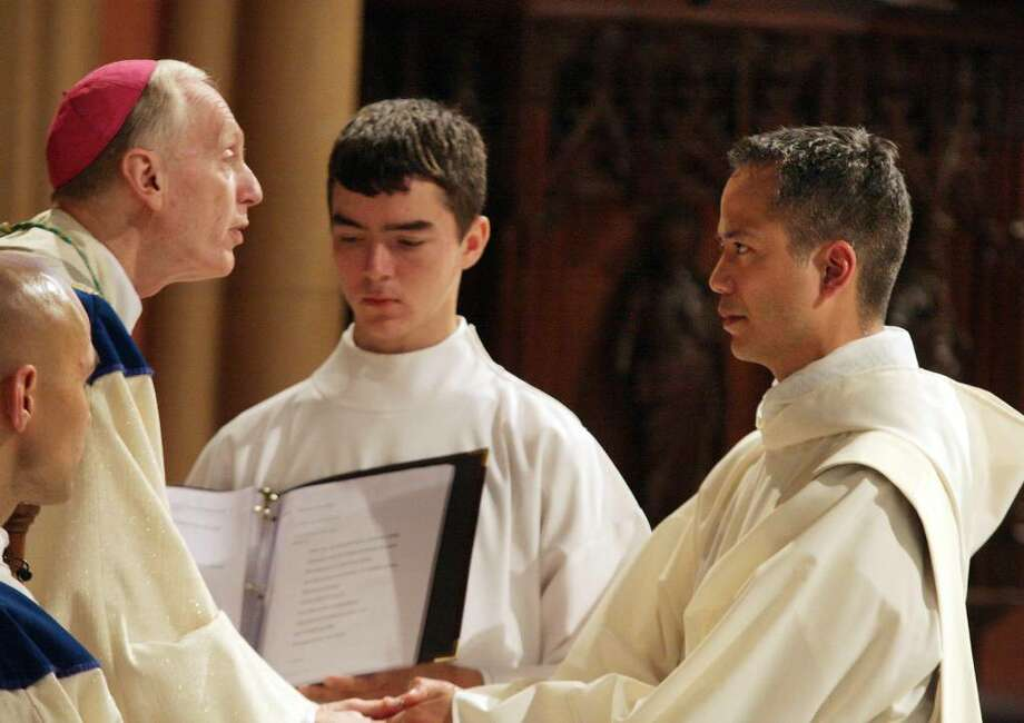 Rev. Rendell R. Torres, right, is ordained by Diocese of Albany Bishop Howard Hubbard at the Cathedral of the Immaculate Conception in Albany. (Courtesy / Roman Catholic Diocese of Albany)