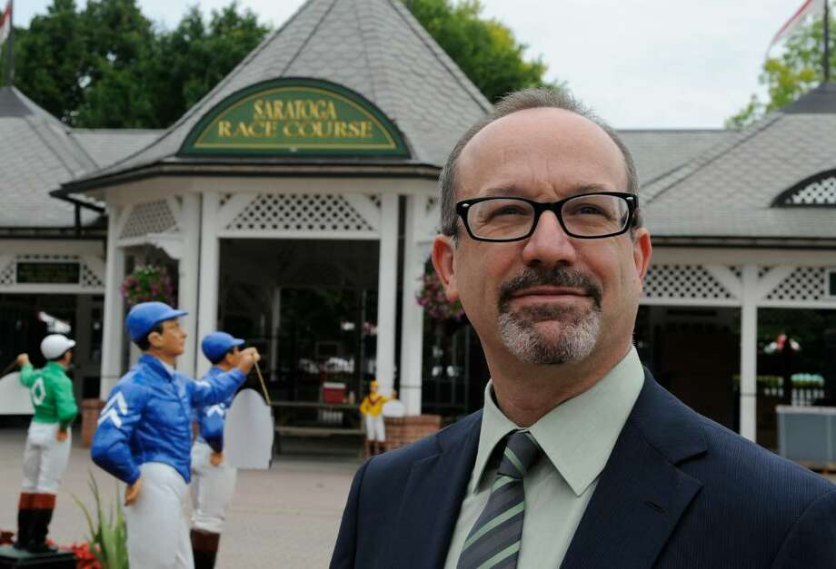 New York Racing Association handicapper Andy Serling, in front of the Clubhouse entrance of the Saratoga Race Course in Saratoga Springs, has never been bashful about his opinions.  (Skip Dickstein/Times Union) Photo: Skip Dickstein