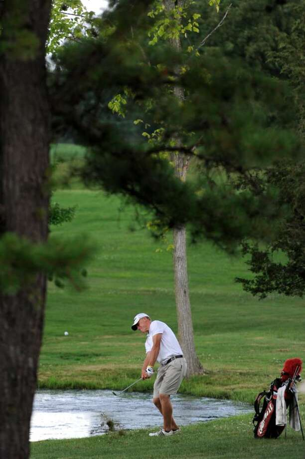 Chris Malec hits out of the fairway at the Albany Country Club during the second round of the New York State Amateur Golf Championships on Wednesday. (Skip Dickstein/Times Union) Photo: Skip Dickstein / 2008