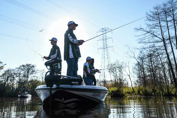 Little Cypress-Mauriceville's Payton LaFleur, 18, center, and Camden Morris, 16, left, practice fishing with their fishing team on the Sabine River in Orange Friday afternoon. Photo taken on Friday, 01/25/19. Ryan Welch/The Enterprise