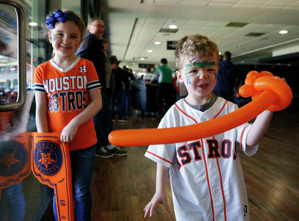 Sister and brother Genevieve Wingard, 6, and Jackson Wingard, 4, have fun at the Astros Fan Fest with their father, Daniel Wingard, and uncle, Michael Wingard, on Saturday, Jan. 26, 2019, in Houston.