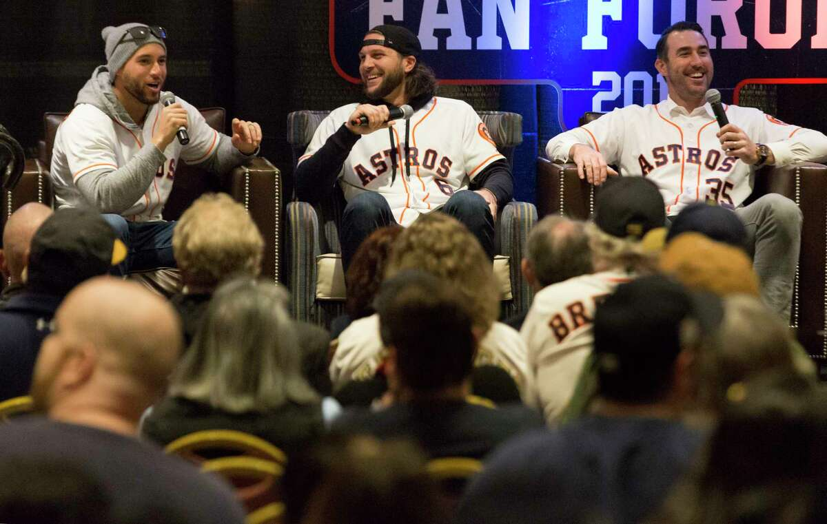 Houston Astros players George Springer, from left, Jake Marisnick and Justin Verlander laugh at Marisnick can't remember his high school mascot while sharing their baseball stories with the fans at the Astros Fan Fest on Saturday, Jan. 26, 2019, in Houston.