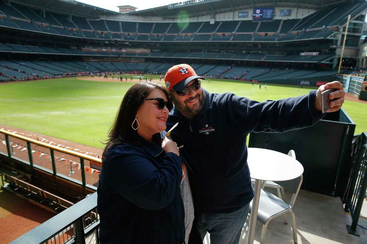 Billy and Amanda Brown take a selfie with the baseball field at the Astros Fan Fest on Saturday, Jan. 26, 2019, in Houston.