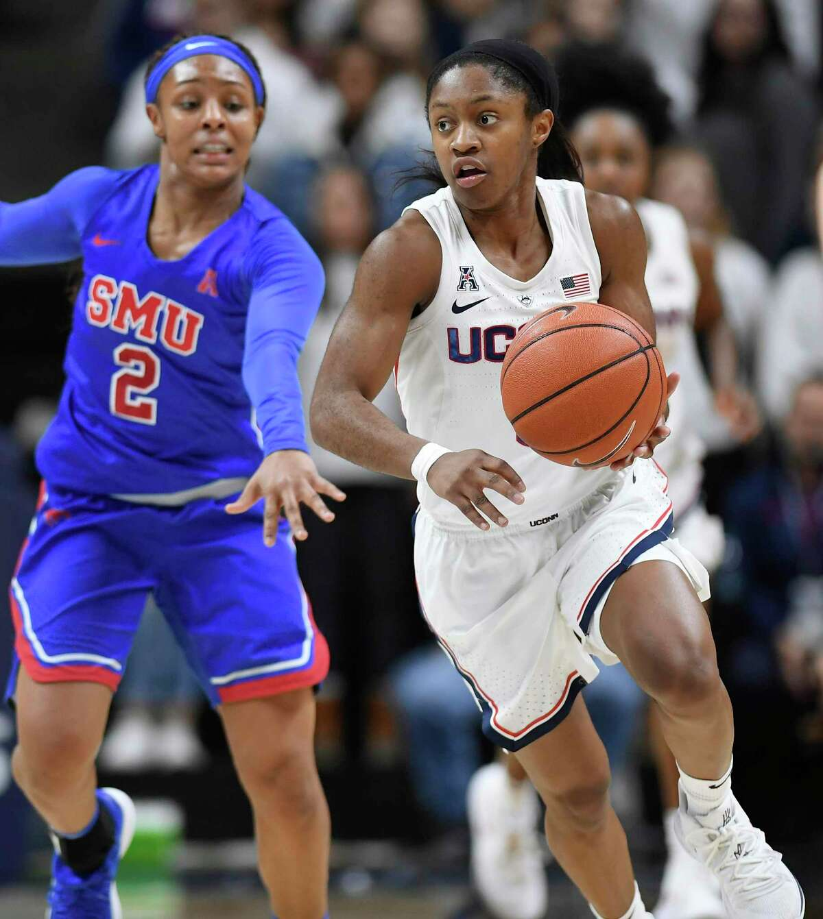 UConn's Crystal Dangerfield, right, pulls away from SMU's Ariana Whitfield on Thursday Jan. 24, 2019, in Storrs.